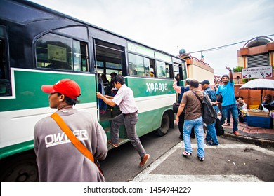 Jakarta, Indonesia : People of Jakarta using Metromini or Kopaja, a single mini bus as public transportation in Blok M terminal, Jakarta (07/2016).