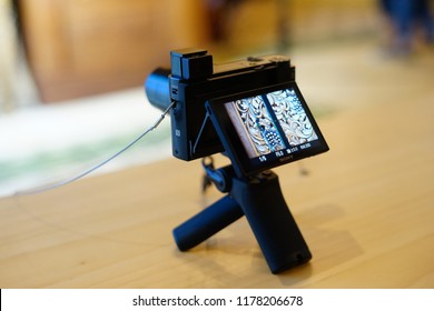 Jakarta, Indonesia - September 13, 2018: The Sony RX100 VI compact camera with shooting grip (VCT-SGR1).