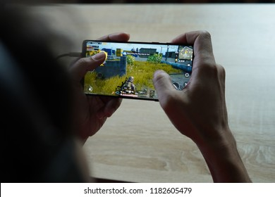 Jakarta, Indonesia - September 18, 2018: The Samsung Galaxy Note 9 Android smartphone playing PUBG Mobile battle royale games.
