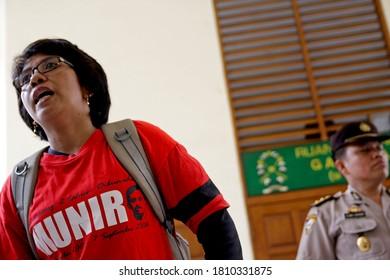 Jakarta, Indonesia. September 2, 2008.  Suciwati, Munir Thalib's widow talk to journalist after  attent to Muhdi Purwopranjono's trial  at Jakarta district court.