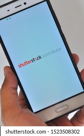 """Jakarta, Indonesia - September 21, 2019: the Android phone with """"Shutterstock"""" on the screen, Shutterstock is a popular microstock agency on playstore in Indonesia."""