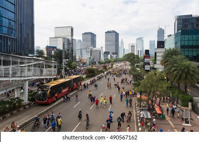 JAKARTA, INDONESIA - SEPTEMBER 25, 2016: People enjoy the car free day, which happens every Sunday morning, on the Sudirman avenue  in Jakarta, where only Tranjakarta bus can run.