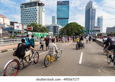 JAKARTA, INDONESIA - SEPTEMBER 25, 2016: Cyclists enjoy riding their custom made bike on car free day, which happens every Sunday morning, on the Sudirman avenue in Jakarta.