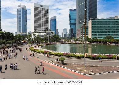 JAKARTA, INDONESIA - SEPTEMBER 25, 2016: People enjoy the car free day, which happens every Sunday morning, on the Sudirman avenue in the heart of Indonesia capital city around the Bundaran HI.