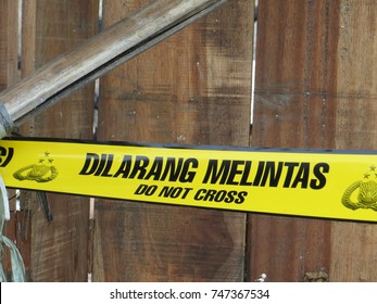 JAKARTA, INDONESIA - September 28, 2017: Police line, yellow tape at a crime scene.
