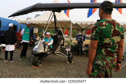 Jakarta, Indonesia - September 28, 2018: Combat watching visitor at microlight trike at the Indonesian Army primary weapons defense system's exhibition at the National Monument.