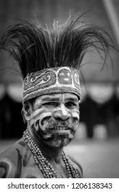 Jakarta, Indonesia - September 4, 2010 - A black and white photo of indigenous man looking at the camera