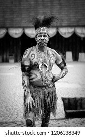 Jakarta, Indonesia - September 4, 2010 - A black and white photo of indigenous man standing looking at the camera