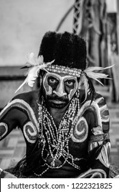 Jakarta, Indonesia - September 4, 2010: Black and white photo of Indigenous wood carver working on his crafts