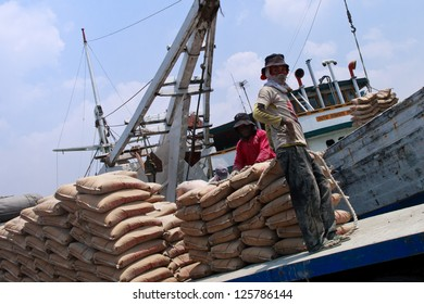 JAKARTA, INDONESIA - SEPTEMBER 6: Workers manually unload bags of cement from a ship at Sunda Kelapa Harbor on September 6, 2011 in Jakarta. There's currently 6.14 unemployment rate in Indonesia.