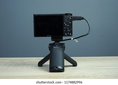 Jakarta, Indonesia - September 9, 2018: The Sony RX100 VI compact camera with shooting grip (VCT-SGR1).