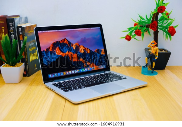 Jakarta, Indonesia: Wednesday 9 October 2019: Macbook on a wooden table