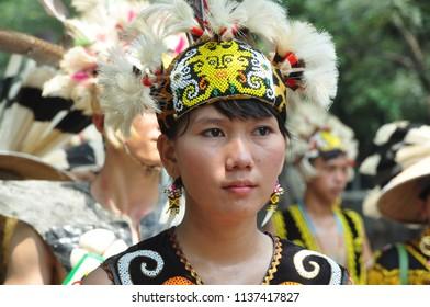 Jakarta, Indonesia-April 28, 2013: Dayak tribe girls in Dayak Culture Festival, Jakarta - Indonesia