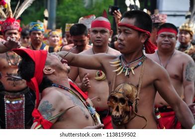 Jakarta, Indonesia-April 28, 2013: Debus Dayak tribe performance at Dayak Festival in Jakarta, Indonesia.