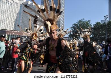 Jakarta, Indonesia-August 27, 2017: Dayak Tribe costume at ASEAN Parade Carnival, Jakarta-Indonesia.