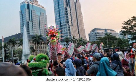 Jakarta, Indonesian - June 30, 2019: Dragon performance as a part of Barongsai dance at Jakarnaval 2019 to commemorate anniversary of Jakarta