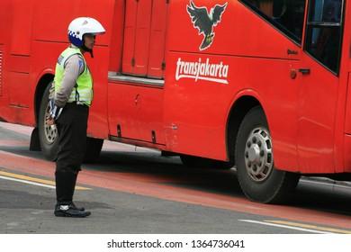 Jakarta, Jakarta/Indonesia ( September 12 2010) :  Indonesian Police Officers on Duty with Transjakarta's Bus on background