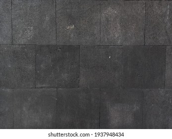 JAKARTA - JANUARY 21, 2021: Industrial black gray stone house wall tiles with large rectangular pattern