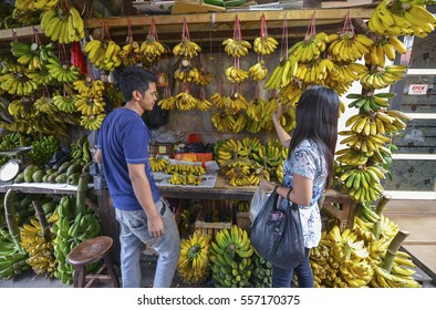 JAKARTA, JAVA, INDONESIA - AUGUST 25: A man selling bananas at a Jakarta market on August 25, 2016 in Java, Indonesia.