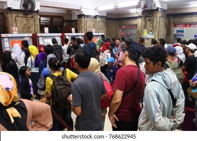 Jakarta November 4, 2017: passenger commuter line passengers buy a passenger card at the jakarta kota station.