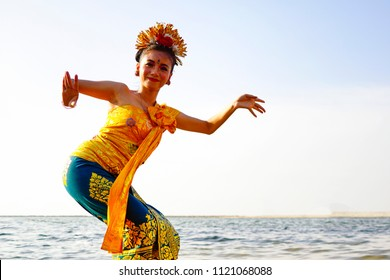 Jakarta, Jakarta Special Region / Indonesia - March 18 2018: Female Balinese dancers are posing in dance movements by the beach.