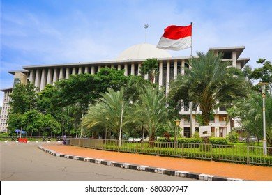 Jakarta view. Istiqlal Mosque with the indonesian flag, the largest Mosque in Jakarta city, Java island, Indonesia, Asia.
