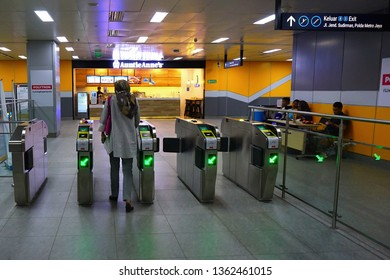 Jakarta,Indonesia April 4, 2019 ; passenger tap in ticket at the mrt ticketing  system  in Jakarta MRT station
