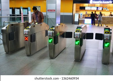 Jakarta,Indonesia April 4, 2019 ; passengers tap in ticket at the mrt ticketing  system  in Jakarta MRT station