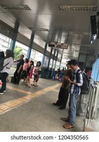 JAKARTA,INDONESIA - JULY 20,2017: People wait for transjakarta at UKI transjakarta bus stop in the morning. But, the bus takes so long to arrive at the bus stop.