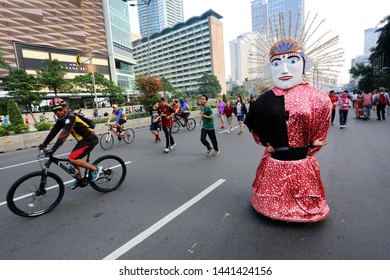 Jakarta/Indonesia-July 17, 2016:Large Ondel Ondel puppet, a tradition from Betawi people originally from Jakarta, perform on a street during the car free day hold every Sunday morning.