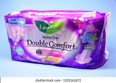 Jakarta-March 5, 2018: illustrative editorial photo- Pack of 18 sanitary napkins brand Laurier on a blue sky background