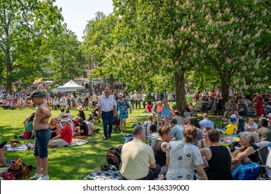 JAKOBSBERG, SWEDEN - JUNE 6, 2019: Summer garden view of people and families outdoors at a green field having picnic on the Swedish national day. Diversity, ages in Jakobsberg Sweden June 6, 2019.