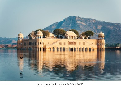 Jal Mahal, Jaipur, Rajasthan, India. Palace on the water of Man Sagar Lake with mountain on the background. Famous travel and tourist attraction