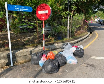 JALAN BANDA KABA, MELAKA MALAYSIA. 6th JANUARY 2019: Rubbish litter bin waste smelly smell bad overloaded packaging environment rubbish litter bins