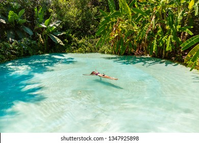JALAPAO, BRAZIL - CIRCA SEPTEMBER, 2018: Woman swims at Fervedouro Bela Vista, one of the crystalline water springs that sprout from the sand that tourists can visit in Jalapao, Tocantins