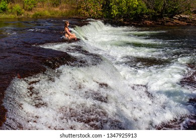 JALAPAO, BRAZIL - CIRCA SEPTEMBER, 2018: Woman bathes in the Soninho River, one of the sources that supplies the dry region of Jalapao, in Tocantins, with crystalline water