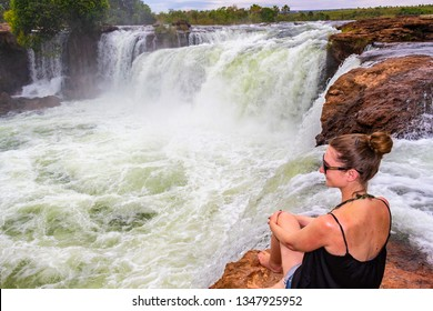 JALAPAO, BRAZIL - CIRCA SEPTEMBER, 2018: Woman looks at Cachoeira da Velha, one of the countless waterfalls that have become tourist attractions in the region of Jalapao, state of Tocantins