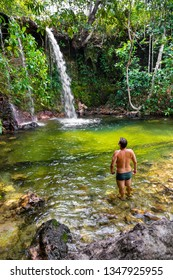 JALAPAO, BRAZIL - CIRCA SEPTEMBER, 2018: Man looks at Cachoeira das Araras, one of the countless waterfalls that have become tourist attractions in the region of Jalapao, state of Tocantins