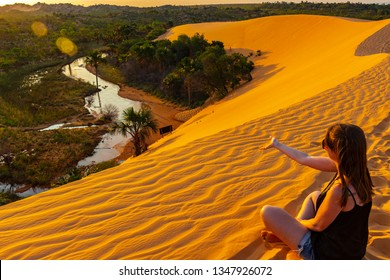 JALAPAO, BRAZIL - CIRCA SEPTEMBER, 2018: Woman watches the sunset on the dunes of Jalapao State Park is one of the most popular tourist attractions in this region of the state of Tocantins