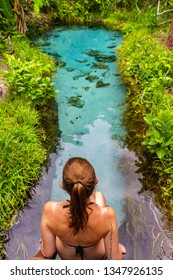 JALAPAO, BRAZIL - CIRCA SEPTEMBER, 2018: Woman looks at Fervedouro Buritizinho, one of the crystalline water springs that sprout from the sand that tourists can visit in Jalapao, Tocantins