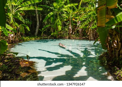 JALAPAO, BRAZIL - CIRCA SEPTEMBER, 2018: Woman swims at Fervedouro do Ceiça, one of the crystalline water springs that sprout from the sand that tourists can visit in Jalapao, Tocantins