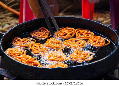Jalebi is a famous indian sweet. This shows how jalebi are 1st fried in oil