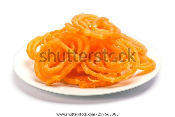 jalebi Indian sweet dish isolated on white background
