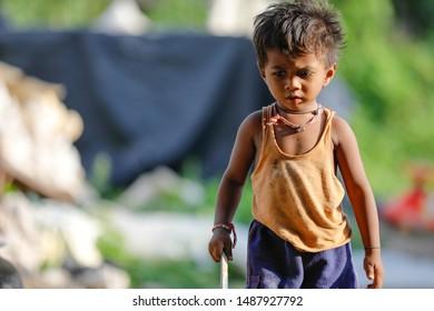 Jalgaon, Maharashtra /India - August 22, 2019: poor Indian child playing