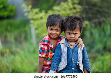 Jalgaon, Maharashtra /India-August 12, 2019 : Poor Indian child smile and showing multi pal expression
