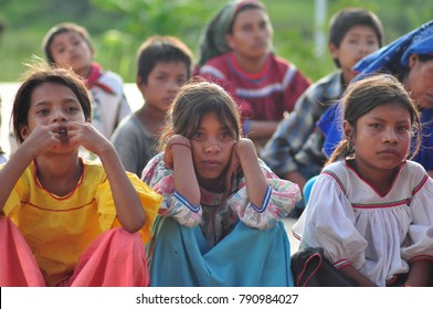 JALISCO, MEXICO- MARCH 22, 2016: Mostly young kids from Huichol Tribe attend class in a open field.