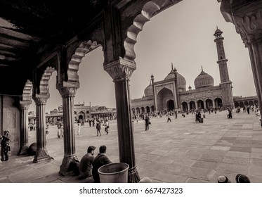 "JAMA MASJID, OLD DELHI, INDIA - 24 JUNE 2017 : Indian ladies devotees doing prayer, as they celebrate the last Friday before Eid. The evening is named ""Shaam-E-Alvida Jumma"", with sepia effect"