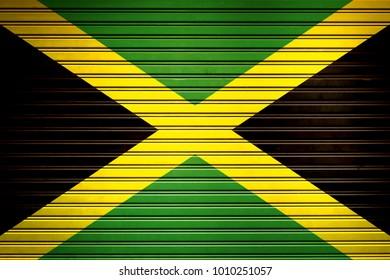 Jamaica Caribbean Flag sign in iron garage door texture, flag background
