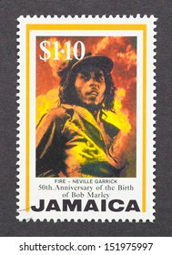 JAMAICA - CIRCA 1995: a postage stamp printed in Jamaica commemorative of the 50th anniversary of Bob Marley birth, circa 1995.