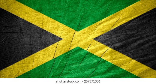 Jamaica flag or Jamaican banner on wooden texture